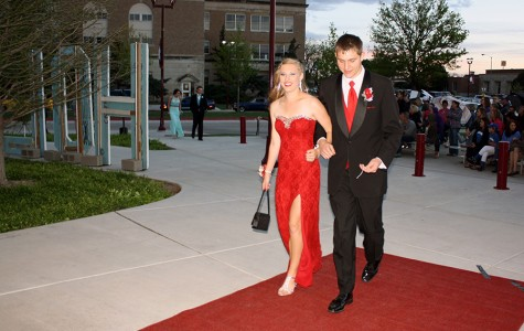 Senior Bailey DeBerry and 2014 graduate Blake Hartman walk the red carpet into Legacy Hall.