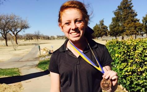 Junior finishes golf season at regionals