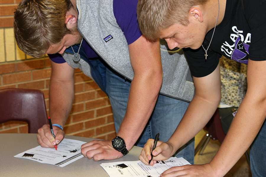 Students sign a