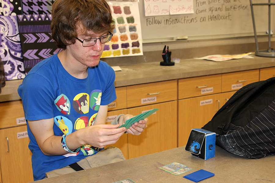 Senior and Anime Club president Tim Archambault plays a game of Vanguard during an Anime Club meeting.