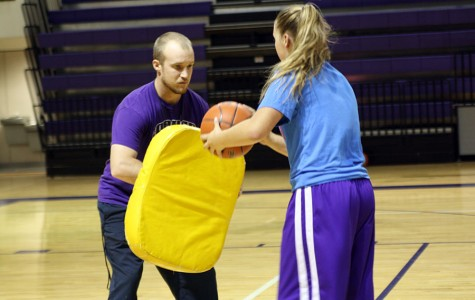 New basketball coach aspires to perform at high level