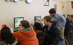 Students teach coding to elementary classes