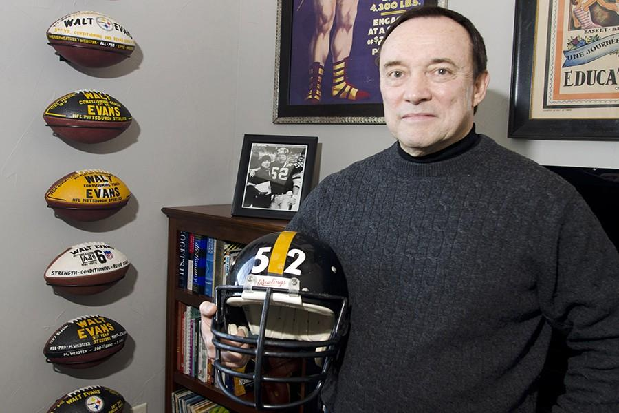 Walt+Evans%2C+former+Strength+and+Conditioning+coach+for+the+Pittsburgh+Steelers%2C+stands+in+his+Aledo%2C+Texas%2C+home+with+the+football+helmet+and+a+picture+of+himself+and+former+center+for+the+team%2C+Mike+Webster%2C+on+December+19%2C+2015.+Webster+is+part+of+the+focus+in+the+upcoming+movie+%26quot%3BConcussion%2C%26quot%3B+which+opens+on+Christmas+Day%2C+and+the+NFL%26apos%3Bs+handling+of+Chronic+Traumatic+Encephalopathy+%28CTE%29.+%28Bob+Haynes%2FFort+Worth+Star-Telegram%2FTNS%29