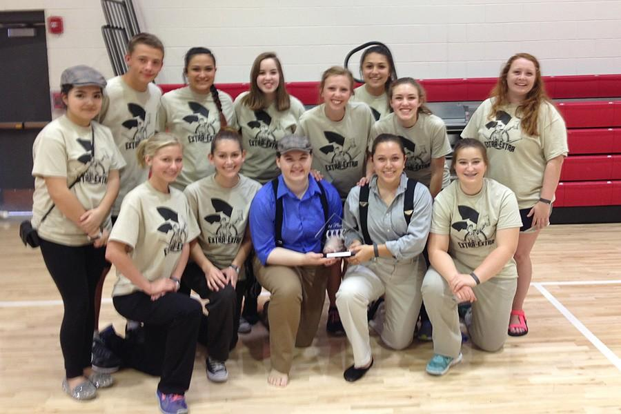 Winterguard+members+celebrate+their+win+following+a+competition.+