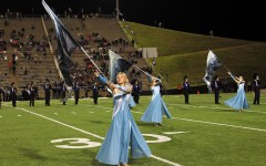 The Colorguard marches with the band Nov. 11 during the halftime show.