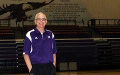 Lady Eagle head coach Joe Lombard will be inducted into the Women's Basketball Hall of Fame June 11. For now, he continues practice in the gym, under the watchful eye of the eagles in murals painted on the walls.