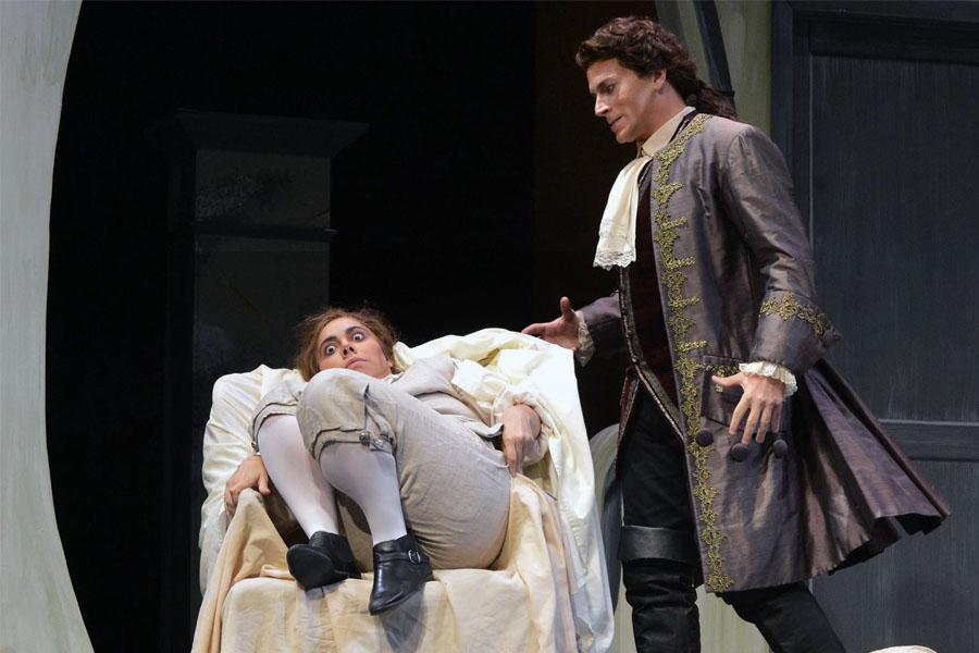 Count Almaviva, played by James Wright, finds Cherubino, played by Eliza Bonet, hiding under a blanket.