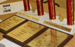 Trophies and plaques from the qualifying meet Oct. 30 are on display in Bill Troyer's classroom.
