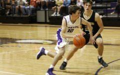 Senior Jared Miller drives down the court against Amarillo High junior Nathan Betts.