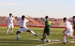 In a match against Pampa, sophomore Luis Contreras leaps to intercept the ball from an opposing player.