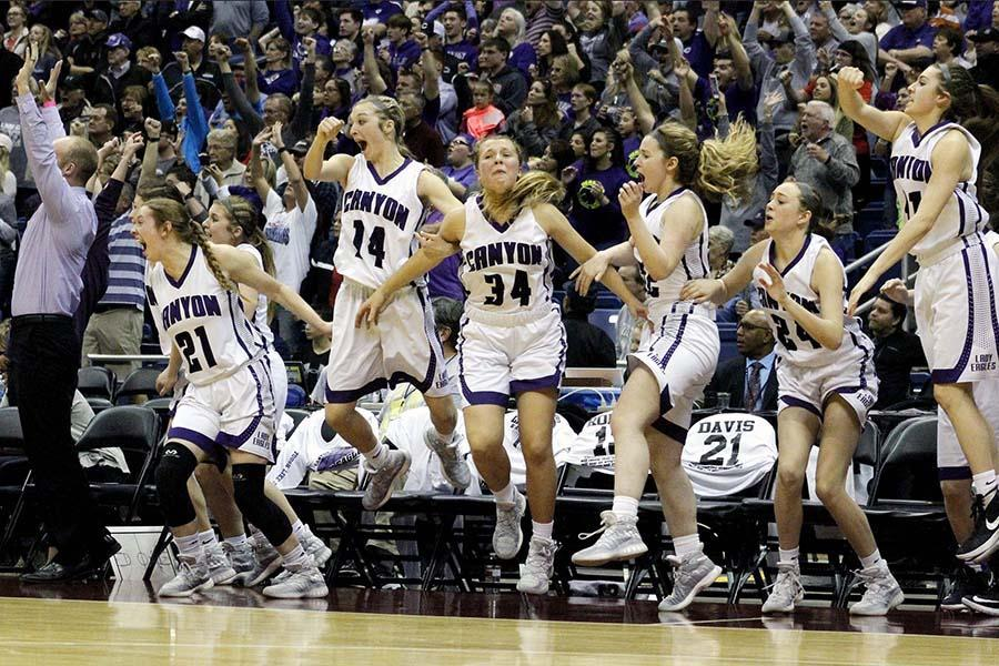Assistant coach Kody Smith, junior Heather Davis, senior Maci King, junior Ayse Allison, seniors Codi Bradstreet and Faith Norman and sophomore Brylee Winfrey jump off the bench in celebration in the last seconds of the state championship game in San Antonio, March 4.