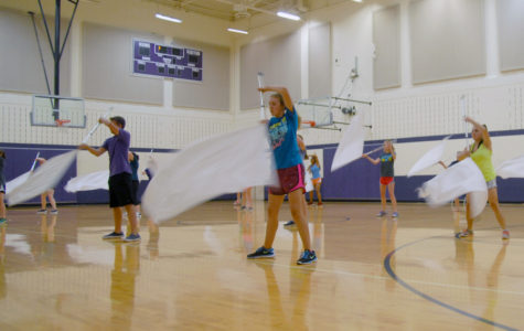 The band's color guard rehearses for their marching show,