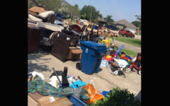 The Boswell family was forced to remove everything from their home for disposal after the flood receded.