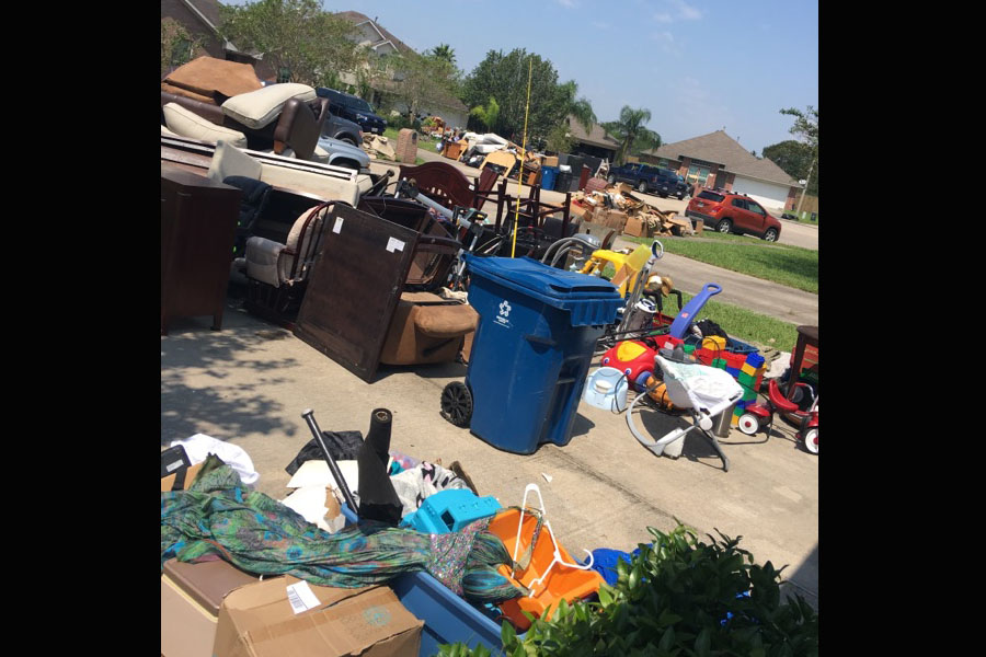 The+Boswell+family+was+forced+to+remove+everything+from+their+home+for+disposal+after+the+flood+receded.+