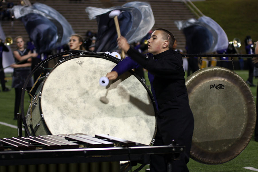 Sophomore Cambry King plays bass drum during the ballad of the band's performance at the football game against Palo Duro.