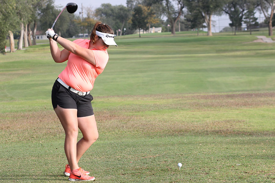 Senior Macy Mitchell hits her driver at the Plainview Triangular in October.