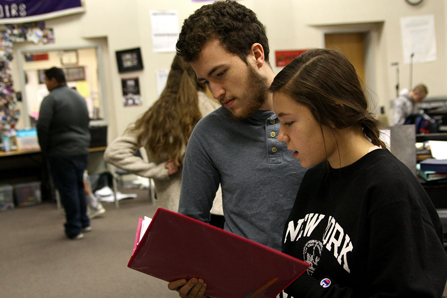 Senior Mitchell Hernandez practices with sophomore Mia Bonds in the choir room.