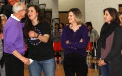 Coach Joe Lombard greets Aubrey Pedigo Terra, Kelli Hardin Mooring and Marsha Eskew.