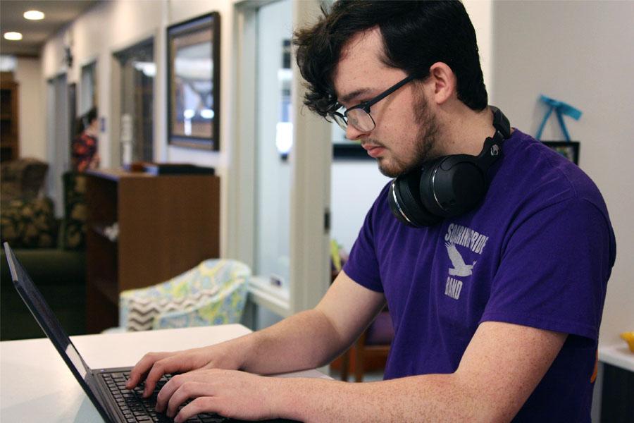 Senior Malachi Kizziar works on the laptop he won.