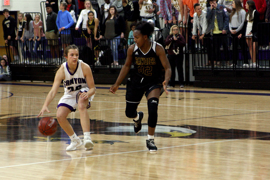 Freshman Kenadee Winfrey dribbles down the court in the Feb. 19 game against Amarillo High, the team they eventually faced in the regional finals.