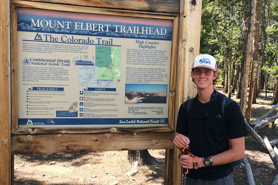 Senior Matthew Wright hikes a trail.
