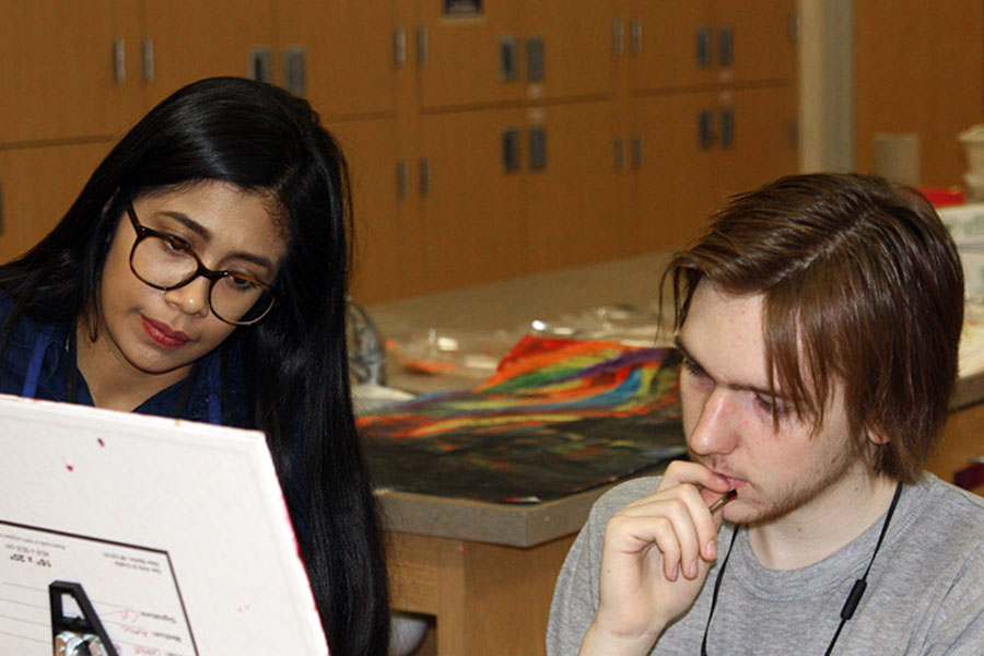 New art teacher Valeria Mayoral works with senior Chance Neese.