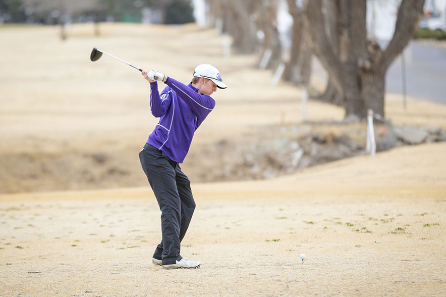 Junior Mason Ketcherside hits on the course.