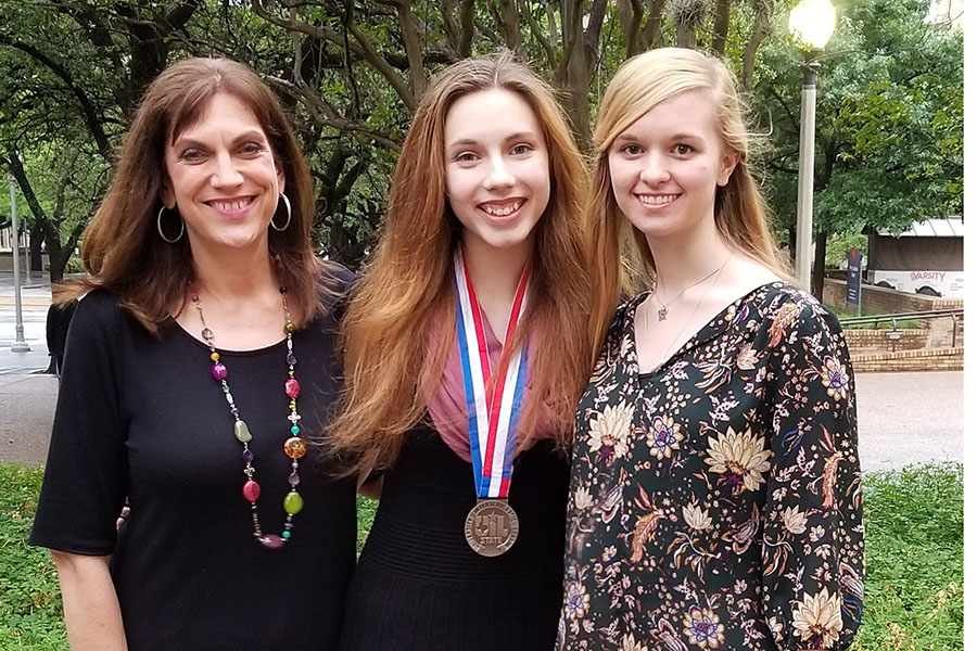 UIL journalism coach Laura Smith celebrates with junior Erin Sheffield, who won a silver medal, and sophomore Macy McClish after both competed in the State UIL Academic Meet in Austin May 4.