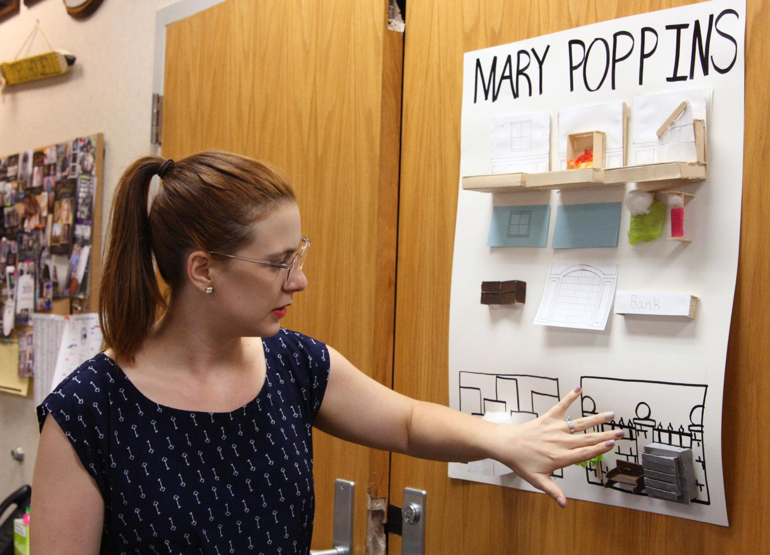 Director Kylie Howell reviews a set construction idea board created by theater students.