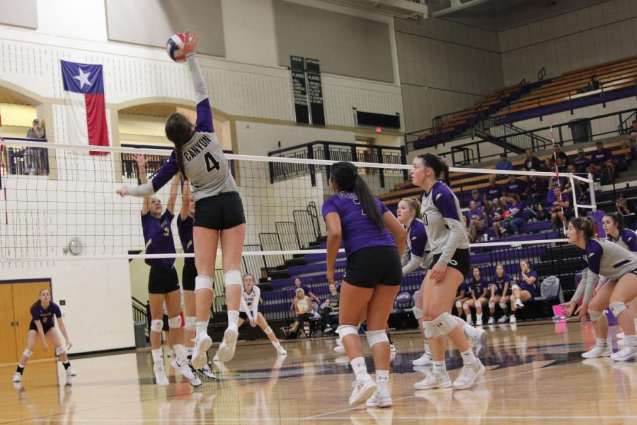Sophomore+Raylee+Bain+hits+the+ball+back+over+the+net+as+she+plays+with+teammates+Hallie+Lacky%2C+Bryli+Contreras+and+McKenna+Coppock+in+preseason+victory+against+Dalhart.+