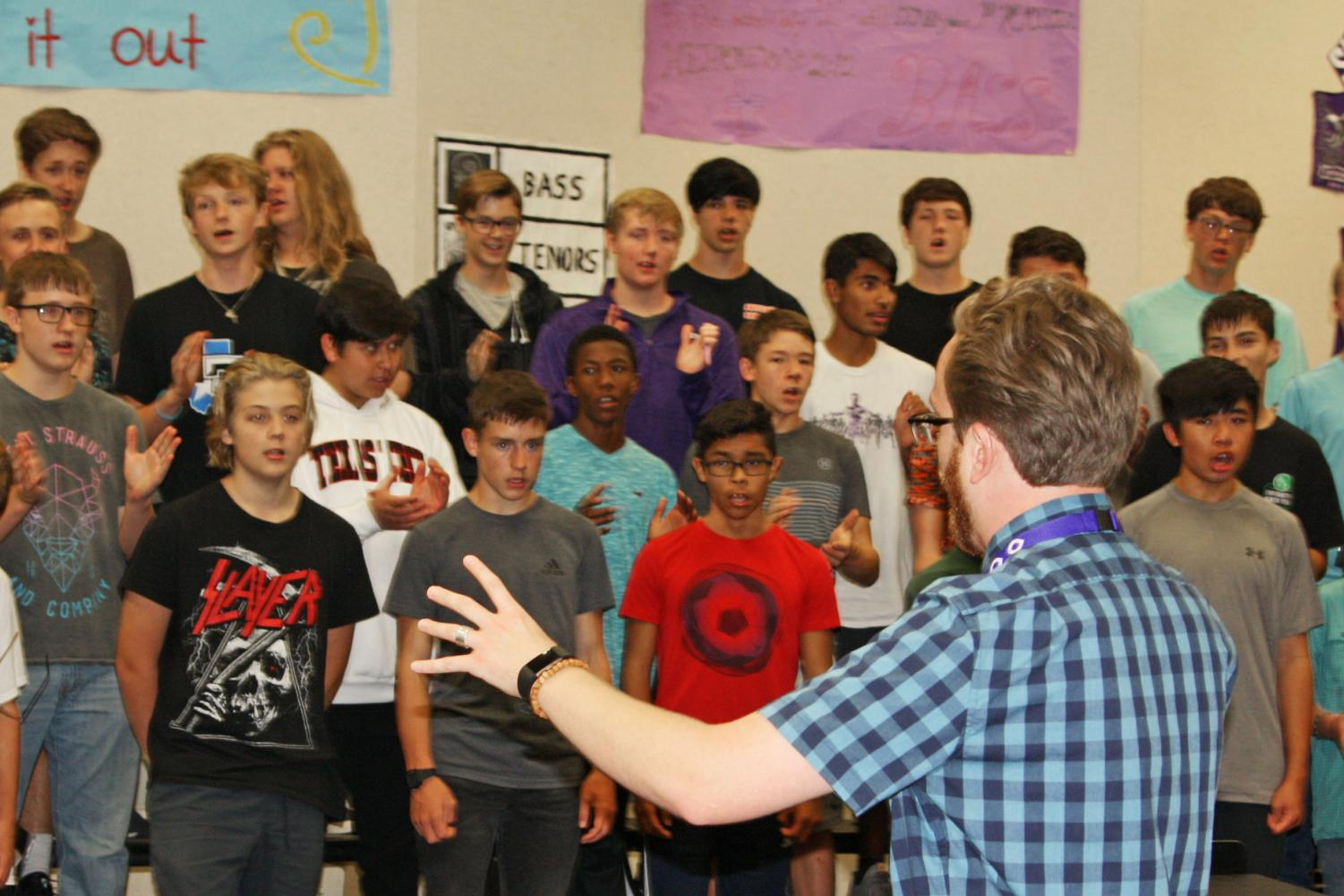 Assistant choir director Reese Kingcade works with Chorale in preparation for the fall concert.