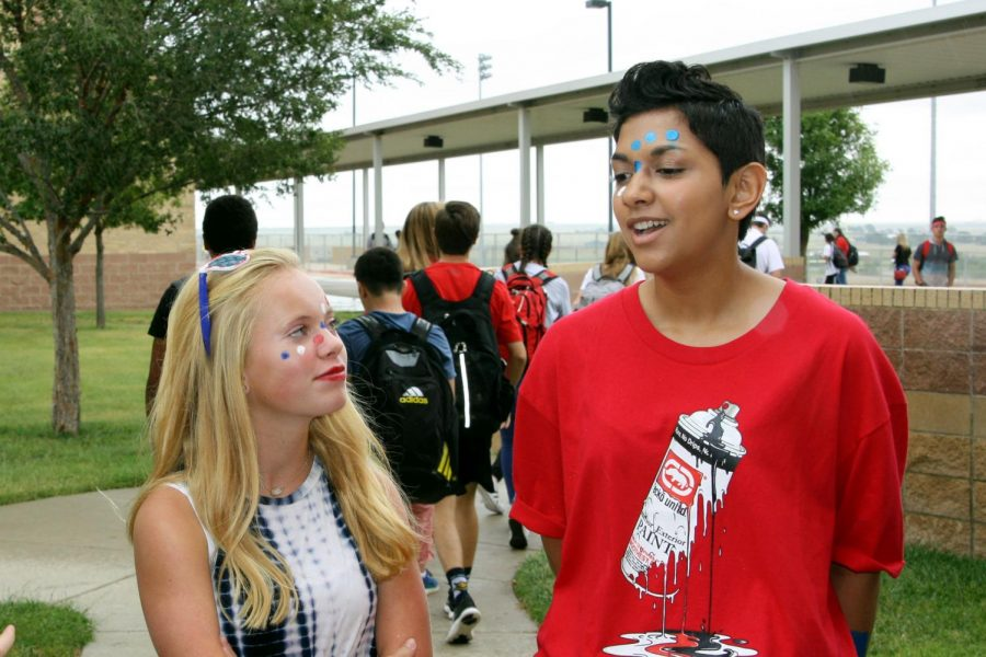 Freshman Charlee Alexander talks with sophomore Alayshea Stewart just before second lunch Friday, Sept. 7.