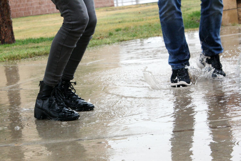 Sidewalks collect rain puddles perfect for splashing.