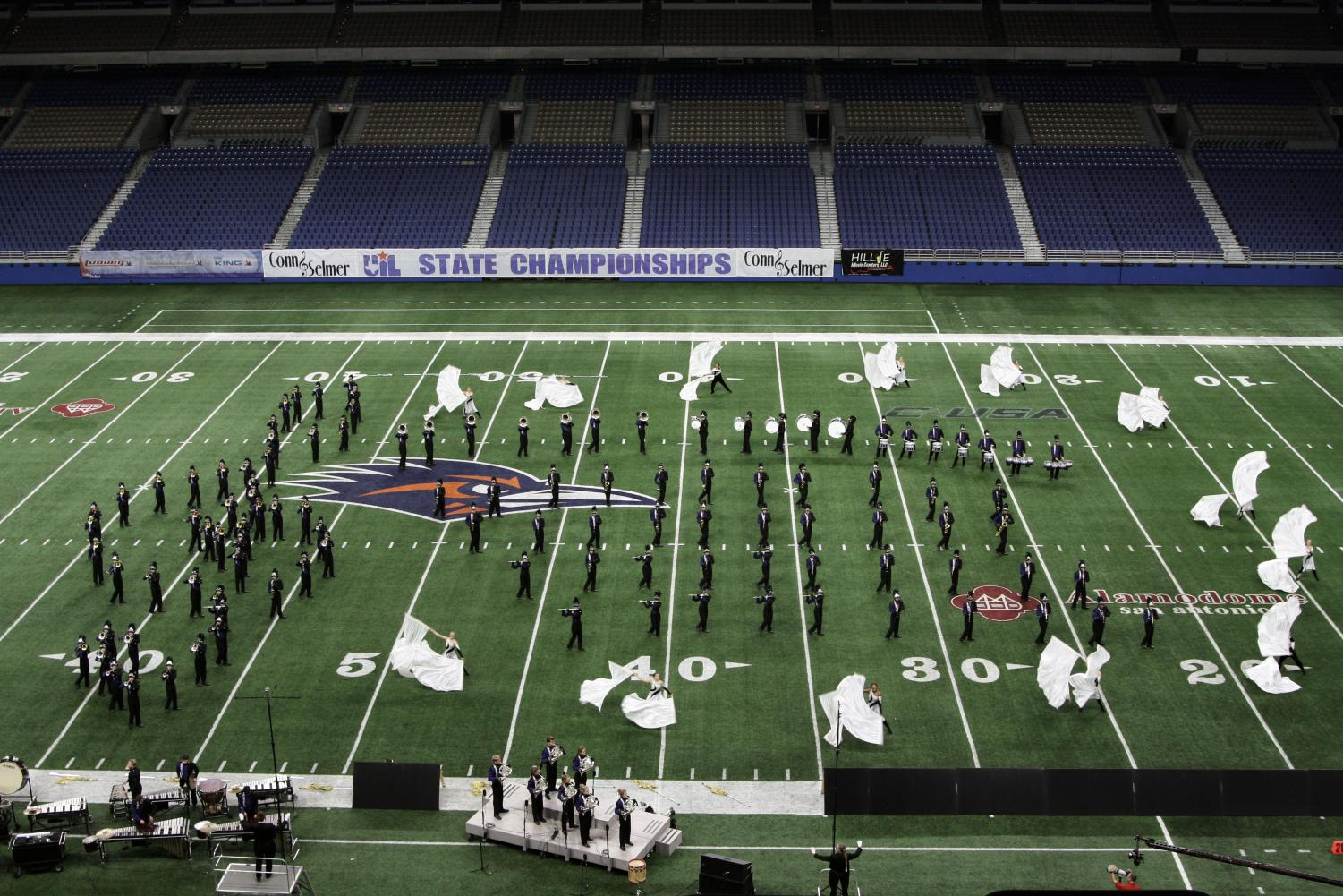 The band creates a treble clef and staff across the field during the ballad.