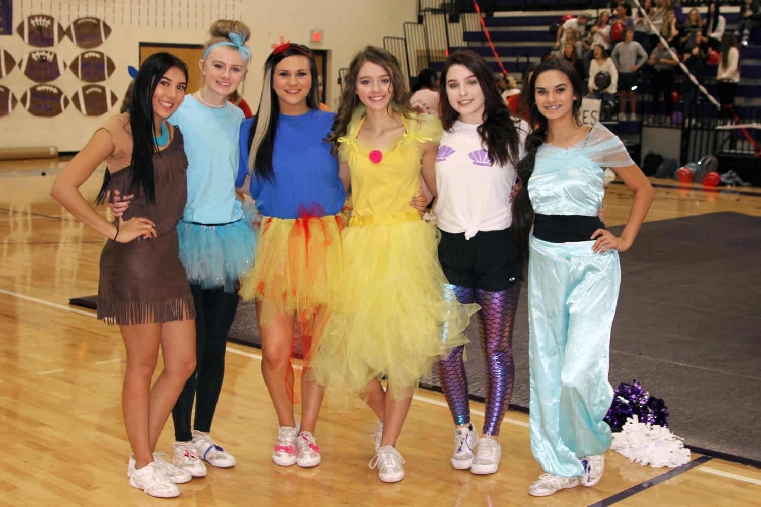 Inspired by Disney characters, cheerleaders dressed in costume for the Nov. 2 pep rally. Alyssa Lackey, Jordan Smith, Addy McCollum, Andi Wilcox, Halee Owen and Kiki Khan represent a variety of Disney heroines.