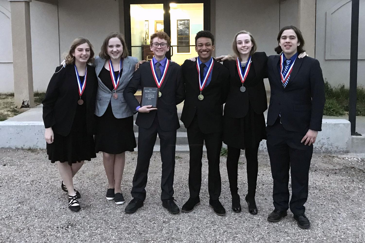 The three state-qualifying cross-examination teams celebrate their new medals.