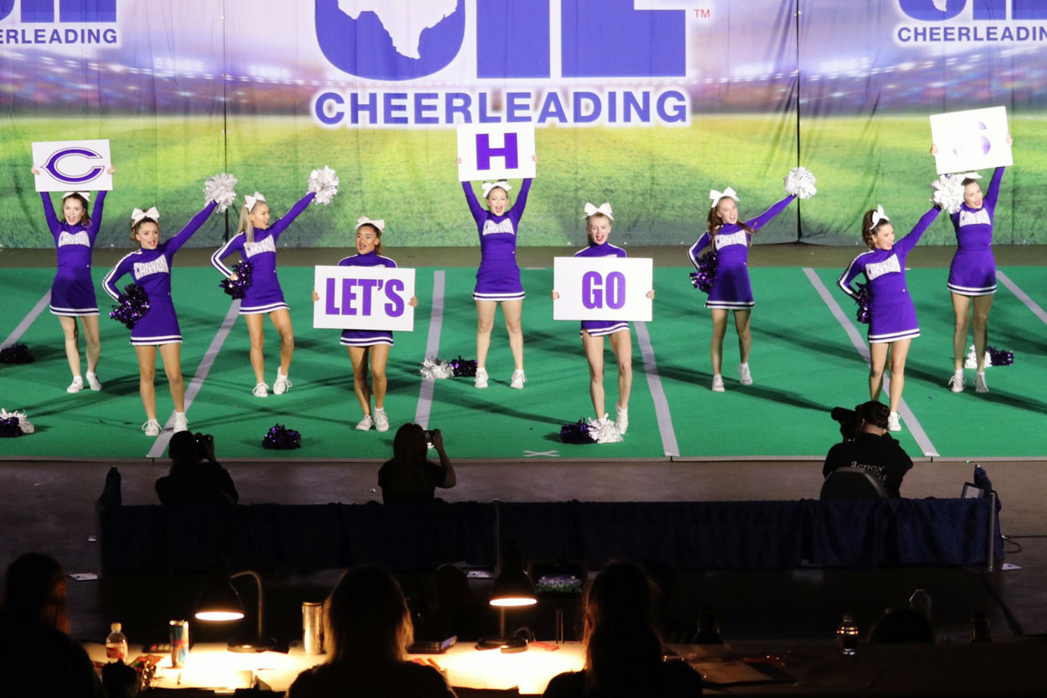 The cheerleaders perform for the judges in the UIL spirit state meet.