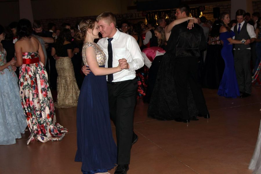 Senoir Caden Zotter and graduate Kelly Wegman dance at last year's prom.