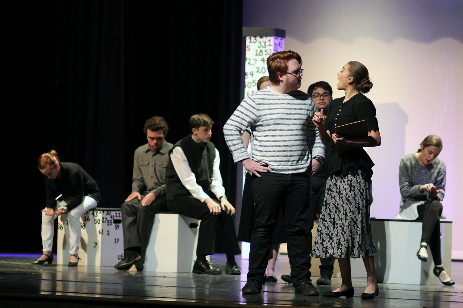 Seniors Seth Nease and Natalie Davis as characters Ed Boone and Mrs. Gascoyne discuss his son Christopher, played by senior Nolan Quintanilla, taking an A level math examination.