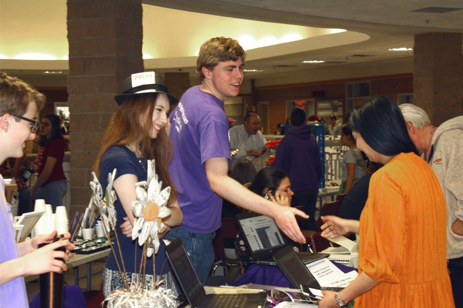 Luke Bruce, Erin Sheffield and Jaren Tankersley greet visitors to the The Eagle's Tale table at the 2018 iCreate event.