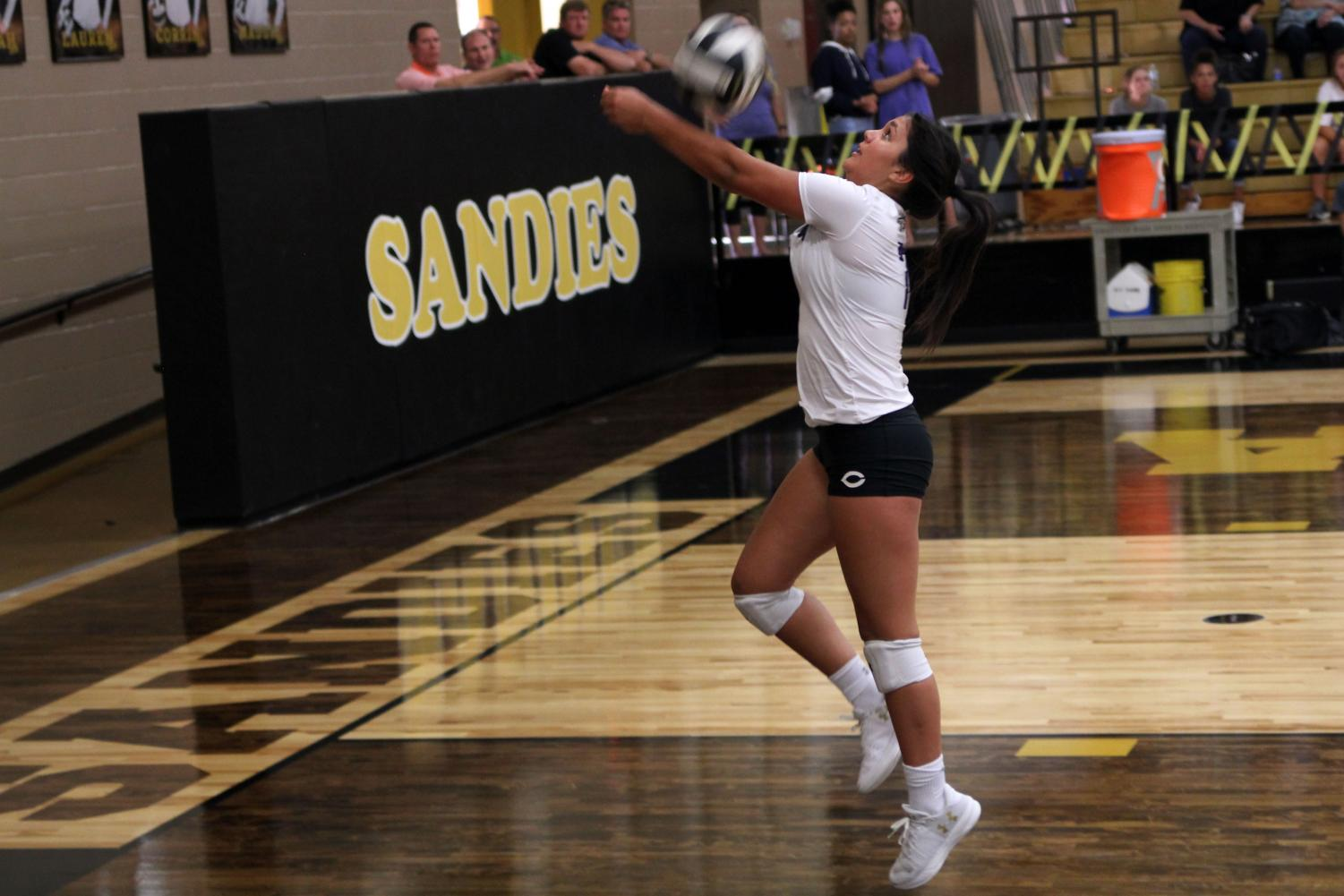 Junior Bryli Contreras returns the volleyball in the varsity team's game against the Amarillo Sandies.