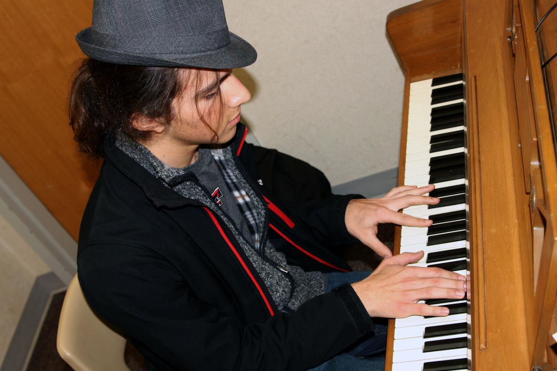 Junior Bret Ramirez improvises jazz music on piano.