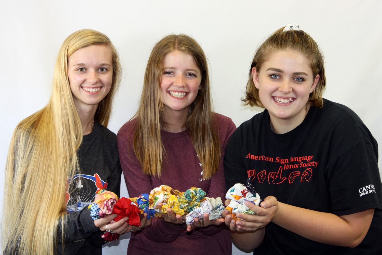 Senior Macy McClish and juniors Emma Wilcox and Kodi Hicks display scrunchies made by McClish.