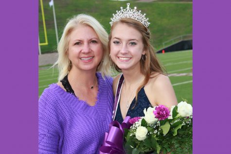 Jacque Green congratulates daughter Lily Green on the sidelines after Lily was crowned homecoming queen prior to the football game against Big Spring.