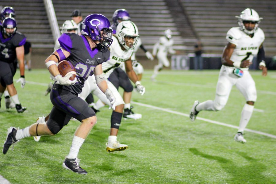 Sophomore Ethan Cowan carries the ball in the team's victory over Big Spring.