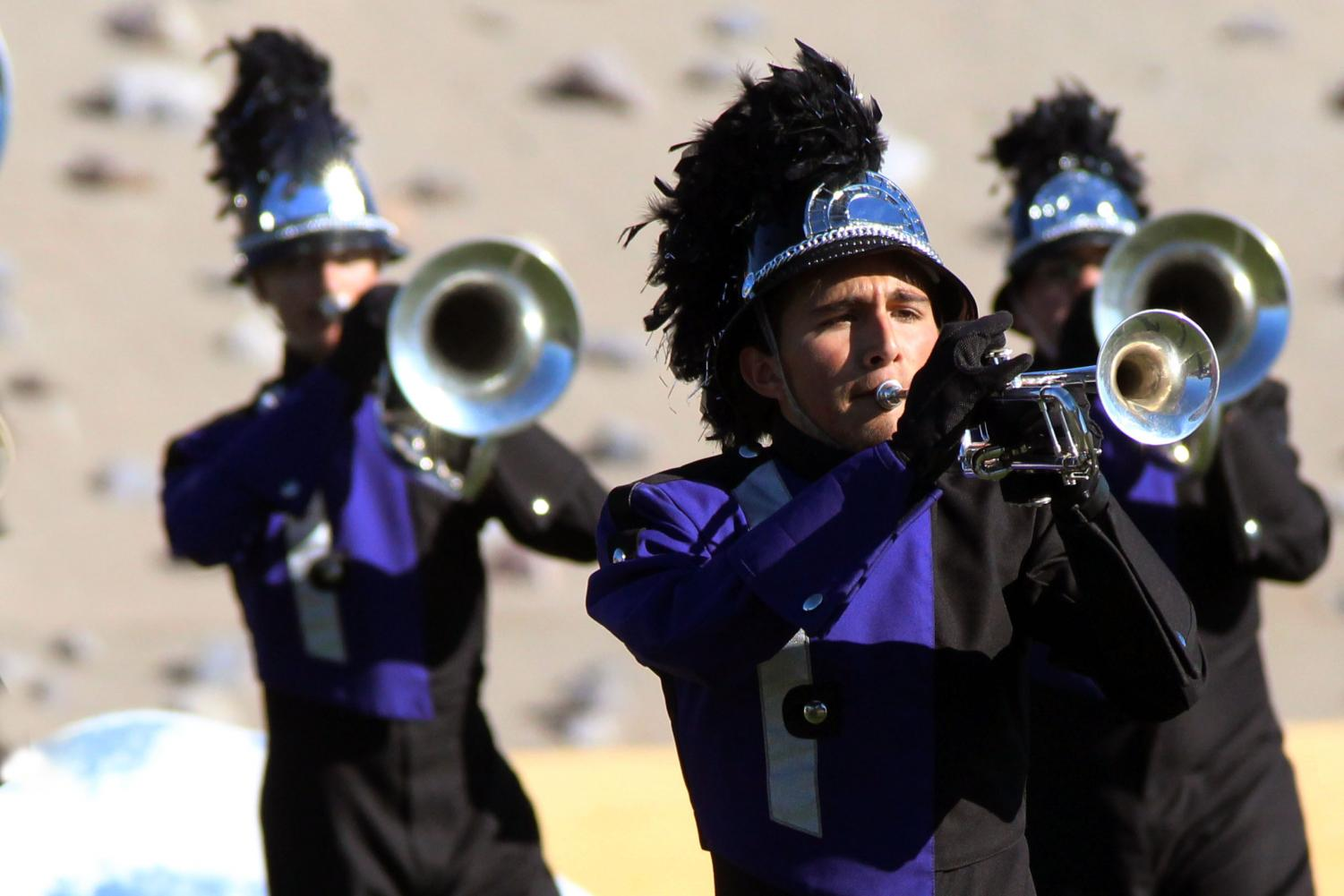 Senior Bret Ramirez marches trumpet, one of many instruments he plays including guitar and piano.