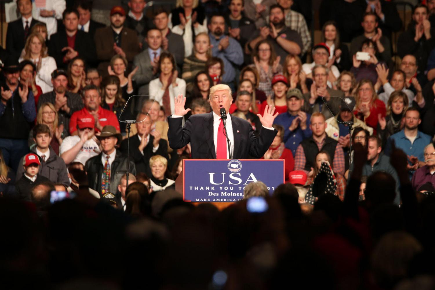 President Donald Trump speaks to supporters at a rally in Des Moines, Iowa.