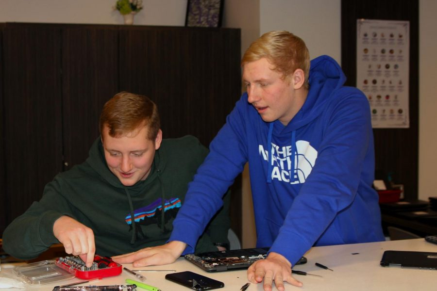 Sophomore+Max+Smith+and+senior+Cooper+Smith+repair+a+Chromebook+using+skills+they+learned+during+the+Dell+training.