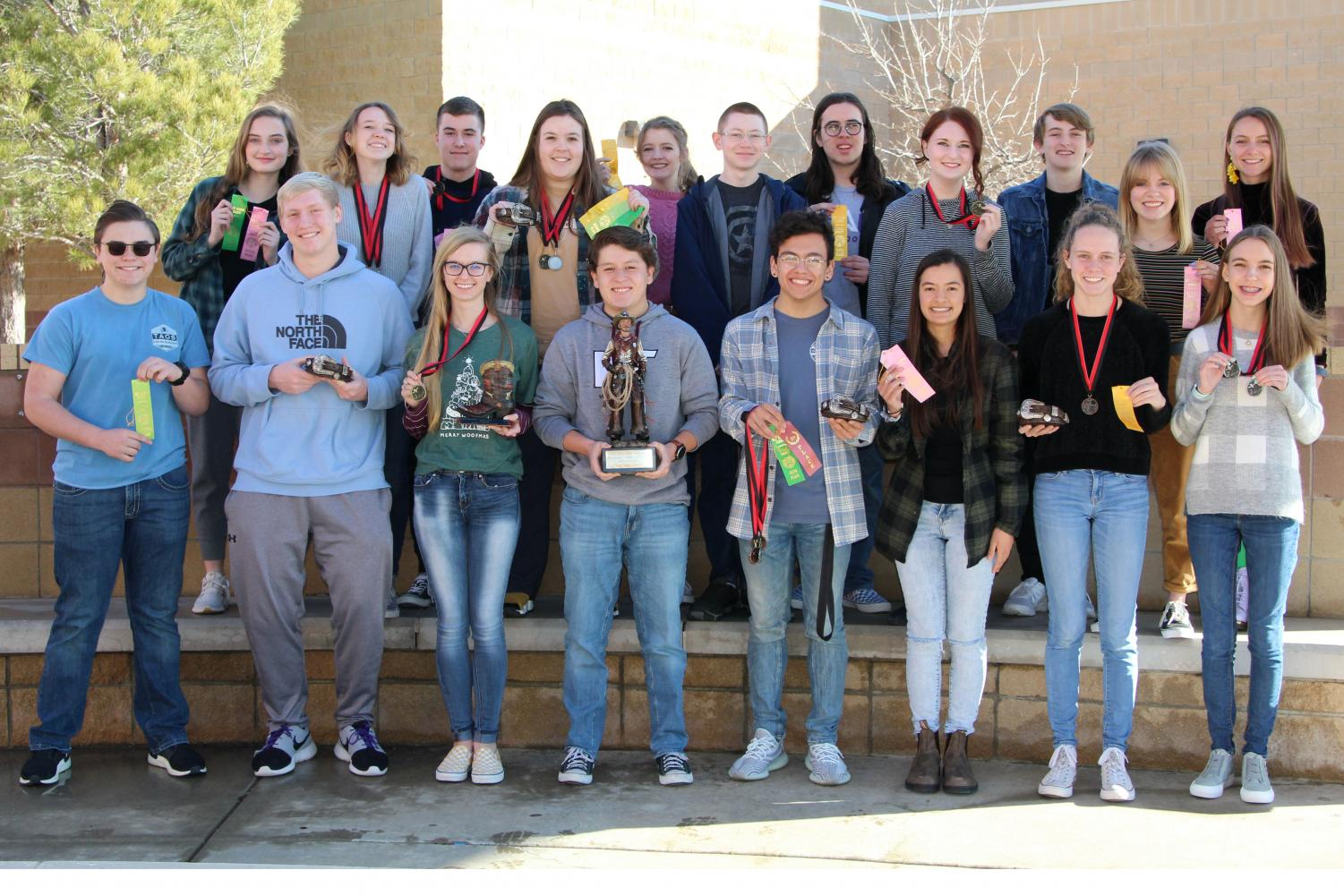 The UIL team consisting of (left to right) Brooklyn Pernell, Claire Meyer, Blake Loria, Cally Lytal, Kodi Hicks, Michael Branton, Josiah Kinsky, Brooklyn Cornelsen, Luke Bruce, Charlie Alexander, Aleah Appel, Brett Rose, Cooper Smith, Macy McClish, Isaac Kendrick, Julian Sewell, Sam Fernandez, Madison Hill and Hannah Backus competed in various UIL events including science, math, social studies, computer science, journalism and literary criticism.