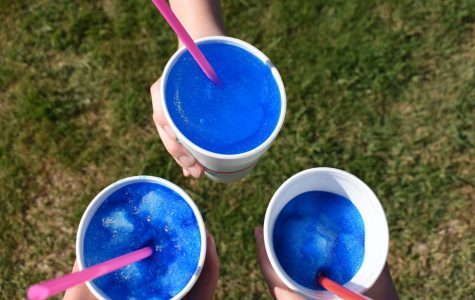 Four staffers got together to compare the blue coconut-flavored snow cones from Sonic, SnoBall Stop and Oasis.